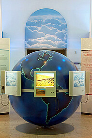 View of the globe in the centre of the exhibition